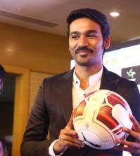 Dhanush holding a football